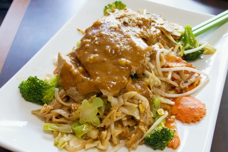 Pad Thai Stir Fried Noodles with Lemon Grass Chicken and Peanut Sauce with Broccoli Carrots Bean Sprouts Stock Photo - 13647337