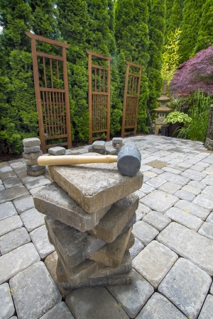 pavers: Stack of Cement Pavers On Backyard Patio for Garden Landscaping