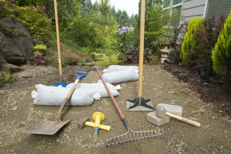 Tools for Excavating and Laying Pavers for Backyard Garden Patio photo