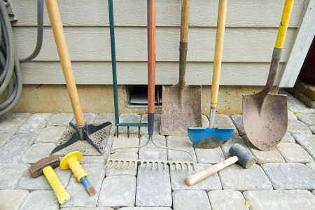 hardscape: Gardening and Landscaping Tools for Yard and Pavers Hardscape Work Stock Photo