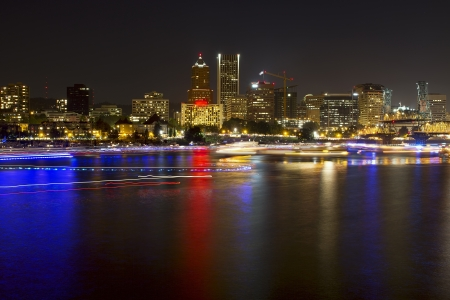 portland oregon: Boat Lights Trails Along Willamette River the City Skyline of Portland Oregon Waterfront at Night Stock Photo