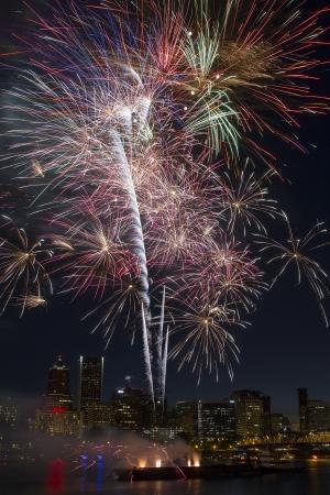 eastbank: Multi-Color Fireworks Display Over Portland Oregon Skyline Along Willamette River Waterfront at Night