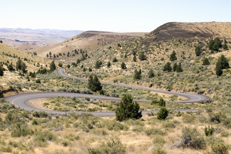 high desert: Long Winding Highway Along High Desert Farmland Landscape in Central Oregon