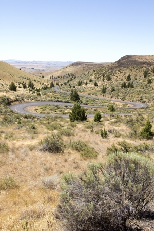high desert: Long Winding Highway Along High Desert in Central Oregon Stock Photo