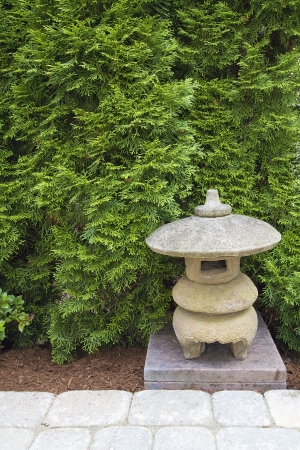 hardscape: Japanese Stone Pagoda in Backyard Garden Paver Patio Stock Photo