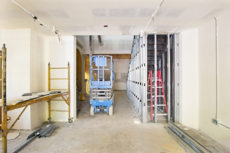 scaffold: Drywall and Framing with Metal Studs in Commercial Space Construction Site Editorial