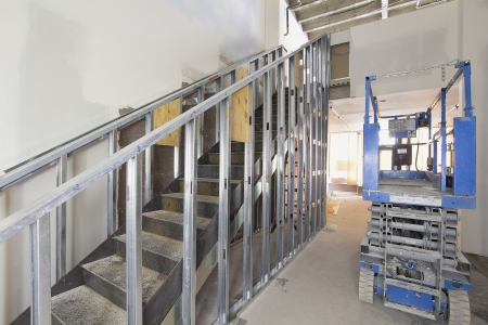 studs: Steel Staircase Construction in Commercial Space with Metal Studs Support
