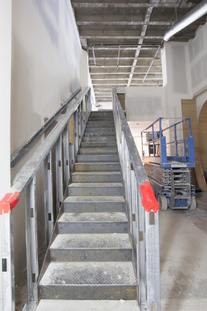 Steel Staircase Construction in Commercial Space  Mezzanine with Metal Studs Support