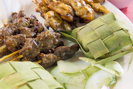 Chicken Beef and Mutton Satay with Ketupat and Cucumbers Closeup