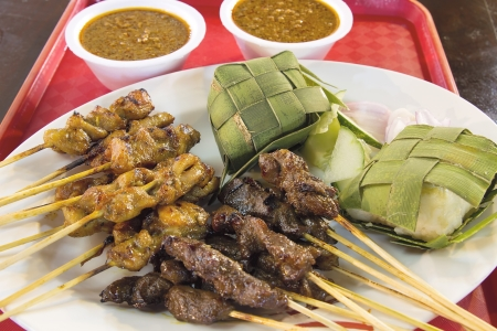 Chicken Beef and Mutton Satay with Ketupat and Peanut Gravy Sauce Closeup