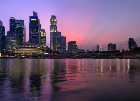 esplanade: Singapore Central Business District Skyline Along River and Esplanade Bridge at Twilight Stock Photo