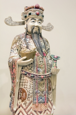 Prosperity Money God Holding Gold Bar and Ruyi Scepter Ivory Carving Statue Closeup