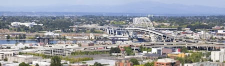 willamette: Portland Oregon Fremont Bridge Over Willamette River and Industrial Area Panorama Stock Photo