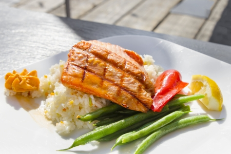 salmon dinner: Grilled Salmon Filet Over Basmati Rice with String Beans and Bell Peppers Stock Photo