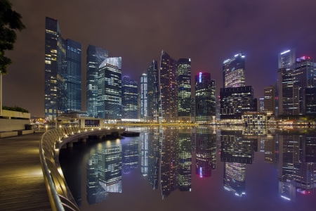 Singapore Central Business District City Skyline Along Marina Bay Boardwalk at Night photo