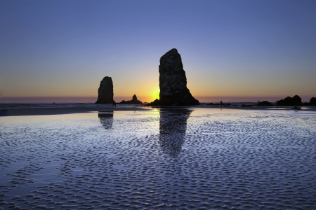Haystack Needles Rocks at Cannon Beach Oregon Coast during Low Tide at Sunset photo