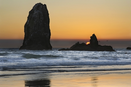 seabirds: Sunset Over Haystack Needles Rock on Cannon Beach Oregon Coast with Waves and Seabirds