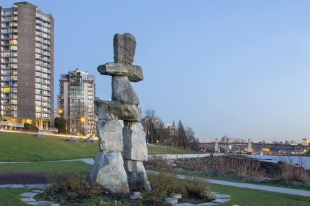 inukshuk: Inukshuk Stone Sculpture on Sunset Beach Alond English Bay in Vancouver BC Canada