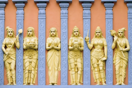 Hindu Temple Exterior Stone Wall Carvings of Goddess and Priestess photo