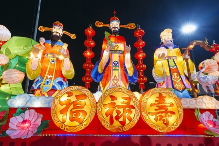 Chinese New Year God of Prosperity Good Fortune and Longevity Statues with Text Symbol Lit at Night Stock Photo - 17068278