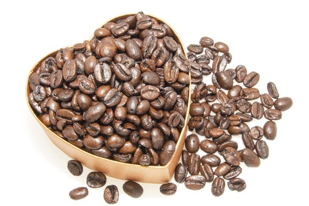overflow: Heart Shaped Gift box Overflowing with Roasted Coffee Beans Isolated on White Background