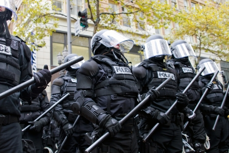 PORTLAND, OREGON - NOV 17, 2011 -  Police in Riot Gear Holding the Line in Downtown Portland, Oregon during a Occupy Portland protest on the first anniversary of Occupy Wall Street November 17, 2011
