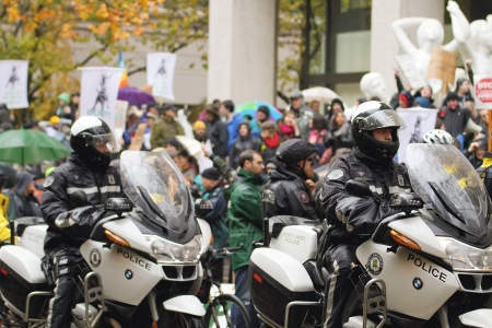 PORTLAND, OREGON - NOV 17, 2011 -  Motorcycle Police Watching over protestors in Downtown Portland, Oregon during a Occupy Portland protest on the first anniversary of Occupy Wall Street November 17, 2011