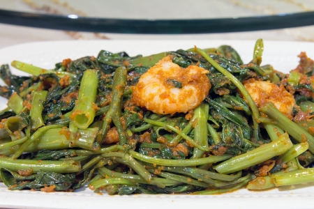 Nonya Peranakan Kangkung Vegetable Blachan Sambal Paste Stir Fry with Prawns Dish Closeup Imagens