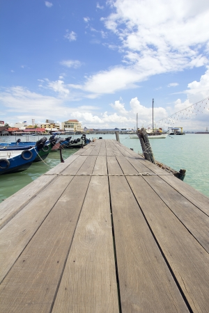 heritage site: Boat Dock on Chew Jetty in Penang Malaysia with Blue Sky