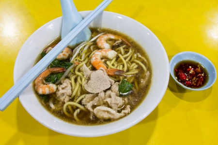 Hokkien Prawn Mee Soup Noodles with Pork and Vegetables and Side Dish of Cut Red Chili Peppers in Soy Sauce photo