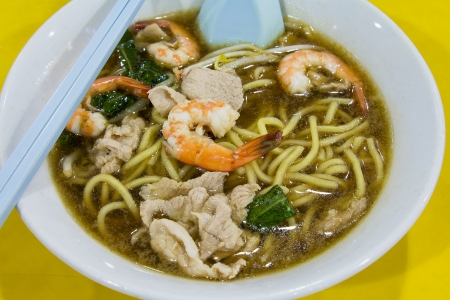 Hokkien Prawn Mee Soup Noodles with Pork and Vegetables Closeup photo