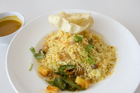 Indian Nasi Briyani Rice Dish with Curry Sauce Pickled Vegetable and Crackers Local Dish photo