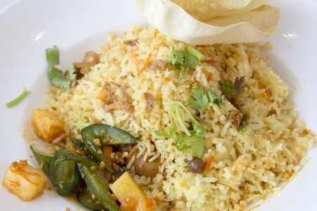Indian Nasi Briyani Rice Dish with Pickled Vegetable and Crackers Local Dish Closeup Stock Photo - 18868524