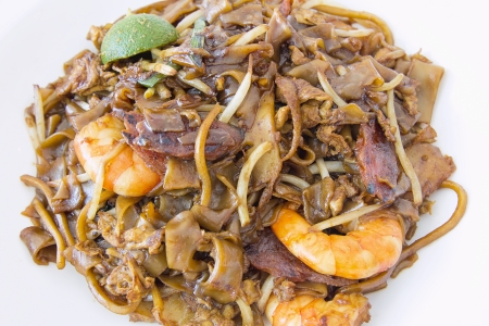 Singapore Char Kway Teow Rice Noodle Stir Fry with Prawns Chinese Sausage and Fishcake Closeup Stock Photo - 18868552