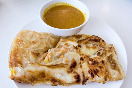 Indian Roti Prata with Chicken Meat and Curry Sauce
