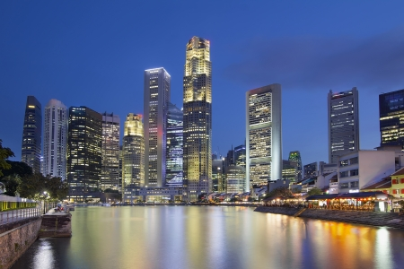 esplanade: Singapore Central Business District  CBD  City Skyline by Boat Quay Along Singapore River at Blue Hour