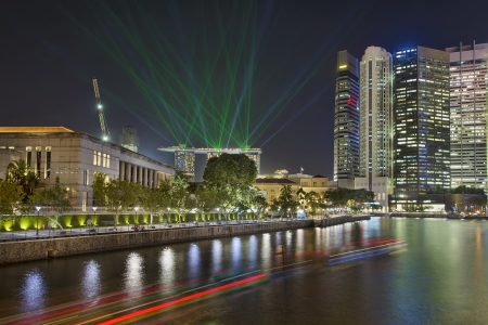 laser light: Singapore Central Business District  CBD  City Skyline by Boat Quay Along Singapore River with Laser Light Show at Night