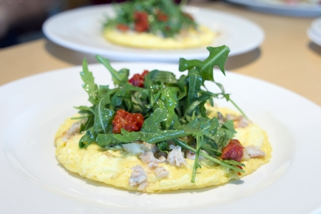 Crab Meat Egg Omelette with Arugula Organic Green Vegetables and Sun Dried Tomatoes photo