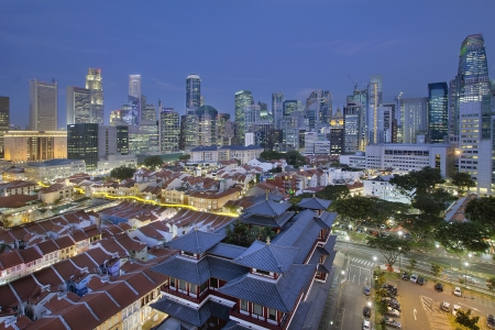 Singapore City Central Business District  CBD  Over Chinatown Area with Old Houses and Chinese Temple at Blue Hour photo