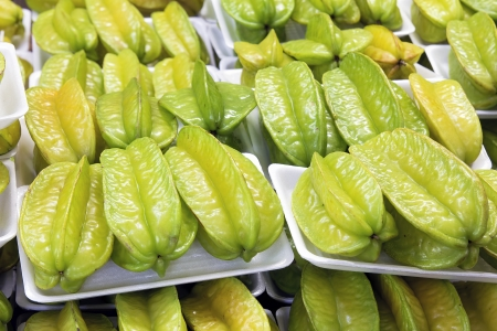 packaged: Starfruits Carambola Fruits Packaged for Sale at Southeast Asian Market Closeup Stock Photo