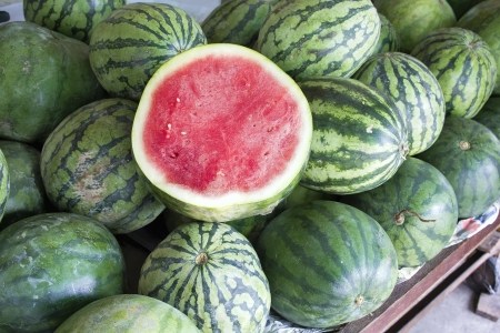seedless: Watermelons Seedless Whole and Halved at Fruit Stand