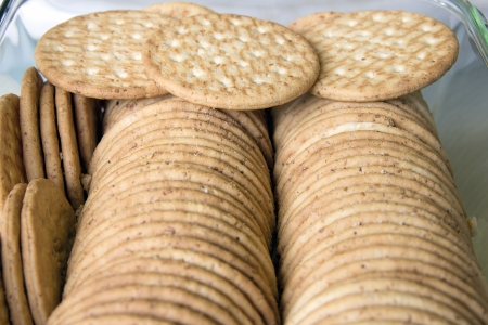 Round Whole Wheat Crackers Stacked in Glass Container Stock Photo - 19293393