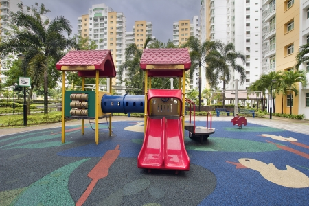 rubber: Rubber Ducky Theme Children Playground with Red Slides in Public Housing in Singapore Punggol District