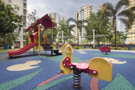 areas: Singapore Public Housing Apartments Animal Ride at Children Playground in Punggol District Stock Photo