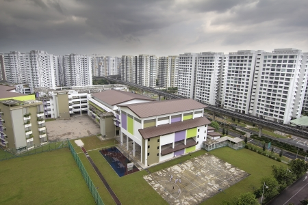 Singapore Goernment Public Housing with Public School in Punggol District Stok Fotoğraf