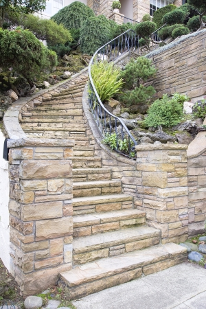 stone stairs: Stone Veneer Faccade on Home Exterior Staircase with Manicured Front Entrance Yard Landscape