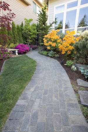 coral bark: Garden Brick Paver Path Walkway with Green Grass Lawn and Landscaping Plants