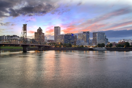 Portland Oregon Downtown City Skyline with Historic Hawthorne Bridge Across Willamette River at Sunset