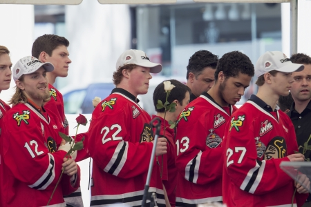 ed: PORTLAND, OREGON, MAY 14 2013: Portland Winterhawks Ice Hockey Team members presented with Rose at Pioneer Courthouse  on May 14, 2013, after winning the Western Hockey League Championship and bringing home the Ed Chynoweth Cup