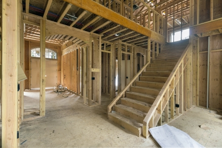New Two-Storey Home Construction Framing Studs with Foyer Area Entryway and Staircase photo